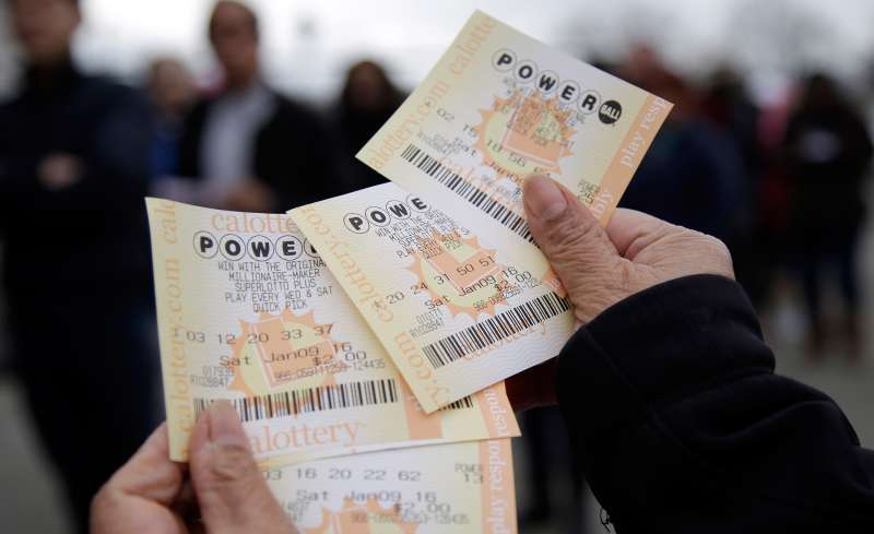 In this January 9, 2016 photo, Powerball tickets are shown in San Lorenzo, Calif. No ticket matched all six Powerball numbers following the drawing for a record jackpot of nearly $950 million, lottery officials said early January 10, boosting the expected payout for the next drawing to a whopping $1.3 billion.