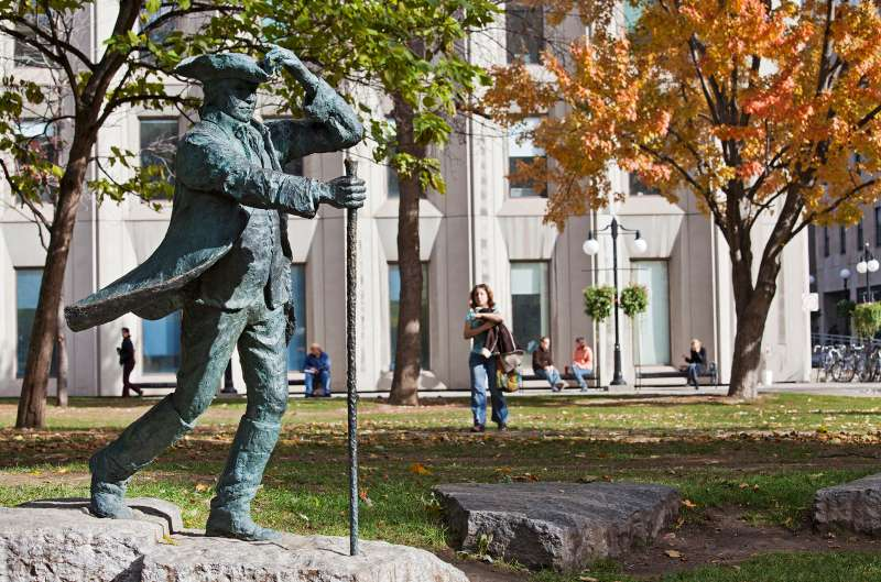 Canada, Quebec province, Montreal, the park of McGill University in autumn, bronze statue of James McGill