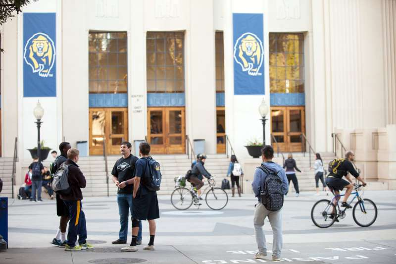Students and visitors walk across campus at the University of California Berkeley, on February 19, 2014 in Berkeley, California.