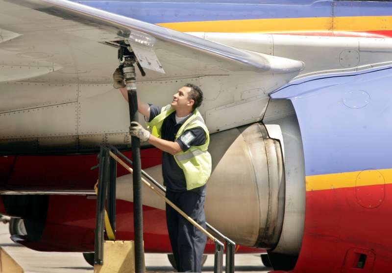 An aviation ground crew member pumps fuel into a Southwest Airlines' plane April 23, 2008, at Los Angeles International Airport.