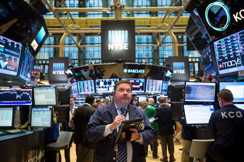 Traders work on the floor of the New York Stock Exchange in New York, U.S., on January 20, 2016.