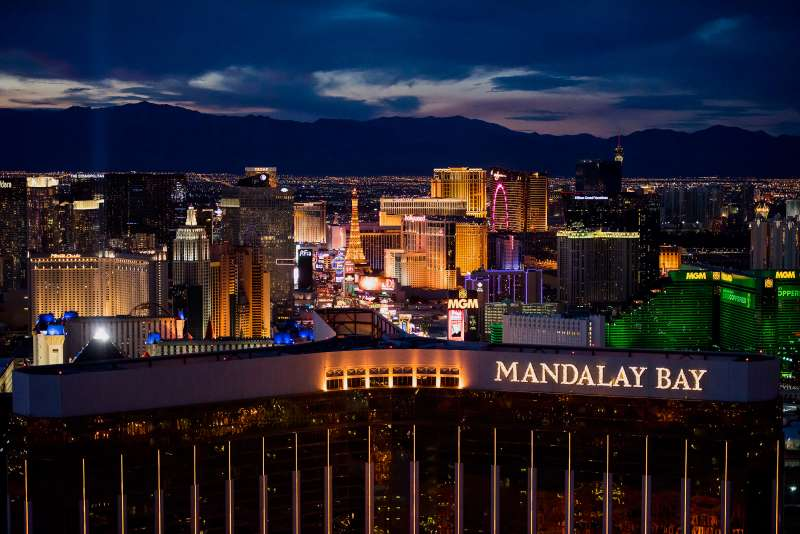Mandalay Bay Resort And Casino, front center, and MGM Resorts International Grand Hotel & Casino, right, stand on The Strip in this aerial photograph taken at dusk above Las Vegas, on August 5, 2015.