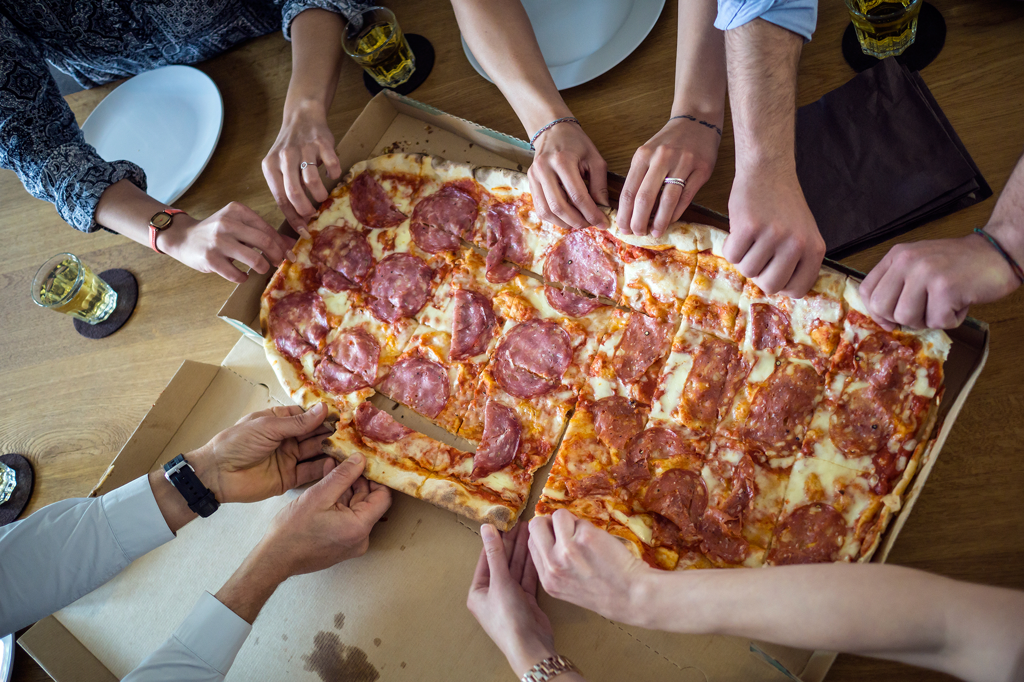 people taking pizza