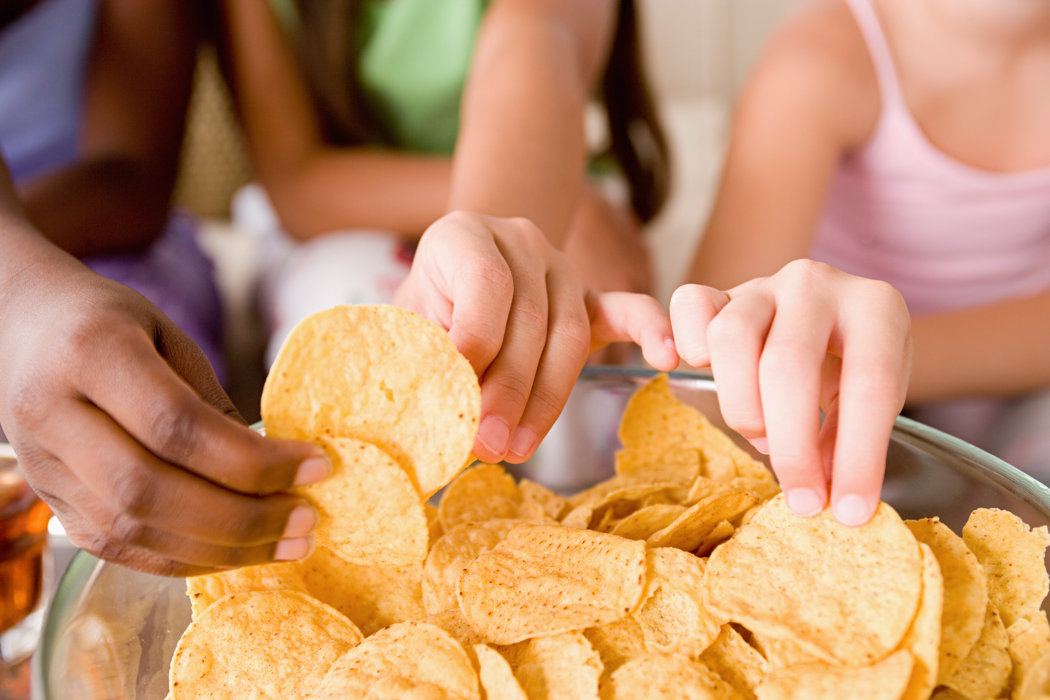 hands reaching for chips