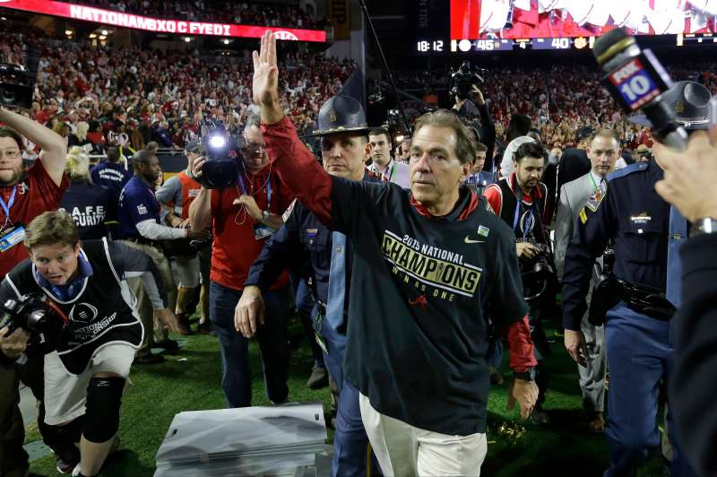 Alabama head coach Nick Saban waves to fans after the NCAA college football playoff championship game against Clemson Monday, Jan. 11, 2016, in Glendale, Ariz