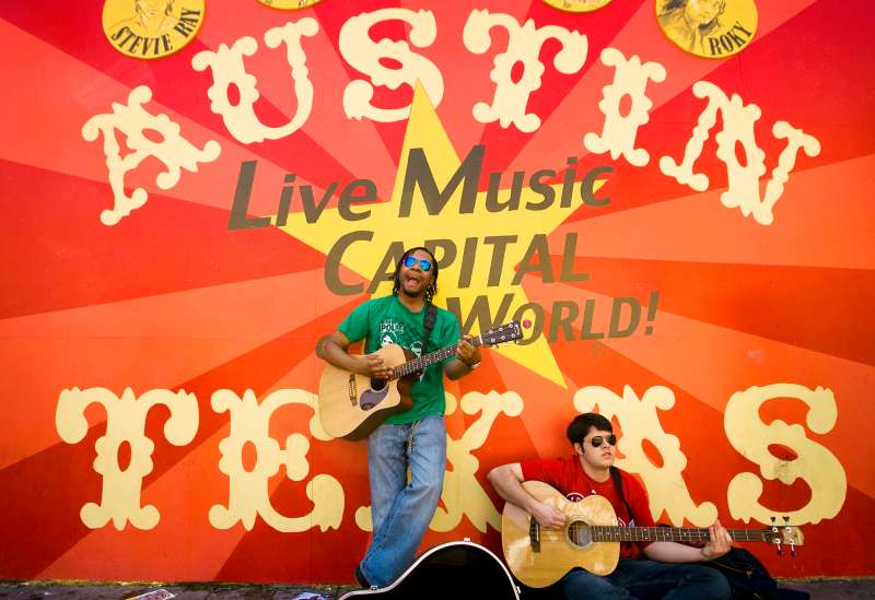 Boy Wonder perform in front of a mural on 6th Street during SXSW