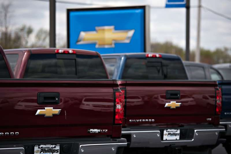 General Motors Co. (GM) 2015 Chevrolet Silverado pickup trucks are displayed for sale on the lot at Phillips Chevrolet car dealership in Frankfort, Illinois, on Thursday, April 30, 2015.