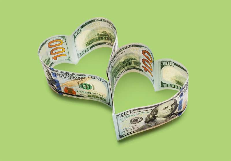 $100 bills in two conjoined hearts