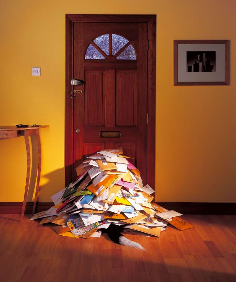 pile of junk mail inside door