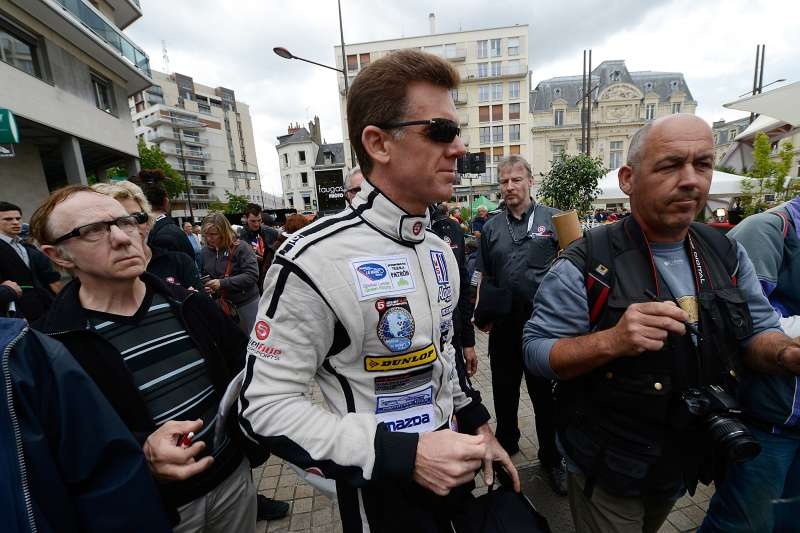 Scott Tucker of the United States and driver of the #33 Level 5 Motorsports HPD Honda during scrutineering for the 80th running of the Le Mans 24 Hour race at Place de La Republique on June 11, 2012 in Le Mans, France.