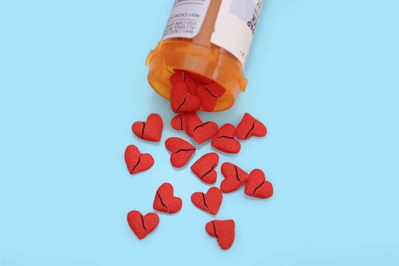 pill bottle spilling out broken heart pills