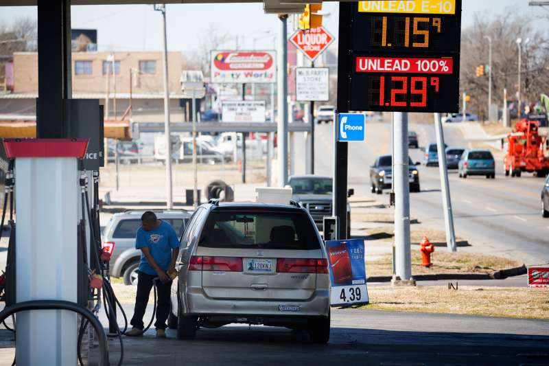 A motorist fills his car with gas February 12, 2016 in Oklahoma City, Oklahoma. Earlier this week prices were cheaper but most gas stations in Oklahoma City were posting higher gas prices today. Prices are expected to start inching upward as spring approaches and refiners begin to throttle back on production to combat oversupply at the same time that demand begins to rise.