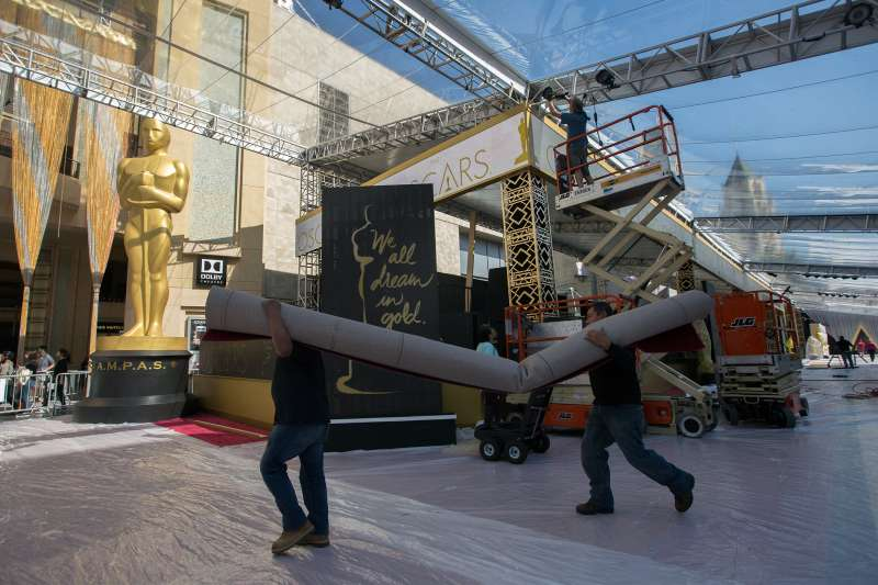 Workers prepare the red carpet arrival area on Hollywood Boulevard for the 88th Annual Academy Awards at Hollywood & Highland Center on February 25, 2016 in Hollywood, California.