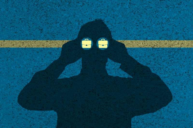 silhouette of man looking through binoculars and seeing briefcases