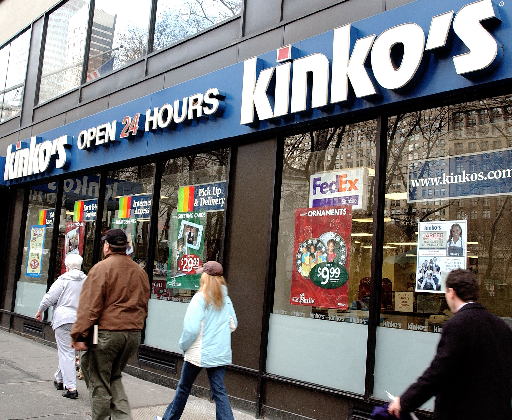 Pedestrians pass by a Kinko's store December 30, 2003 in New York City.