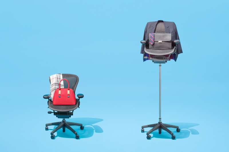 office chairs of two different heights, with male and female fashion accessories draped on them