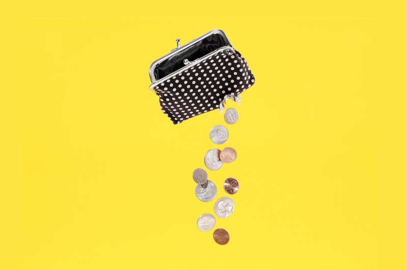 coin purse with hole leaking money