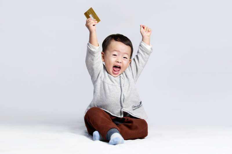 toddler cheering with credit card