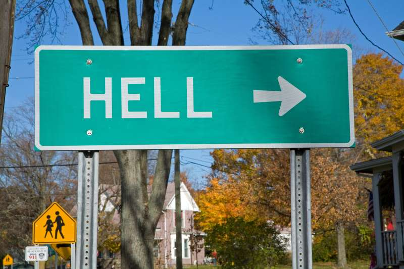 A road sign points towards the small town of Hell, Michigan