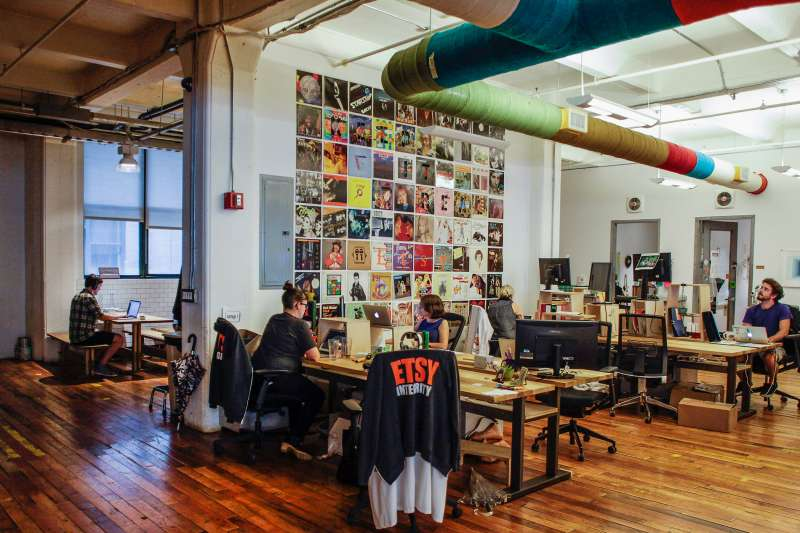 Employees work at Etsy Inc. headquarters in the Brooklyn on August 11, 2015.