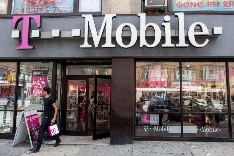 A customer exits a T-Mobile US Inc. store in New York, on July 26, 2015.
