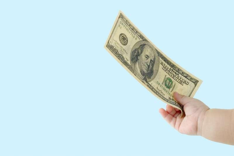 baby hand holding money
