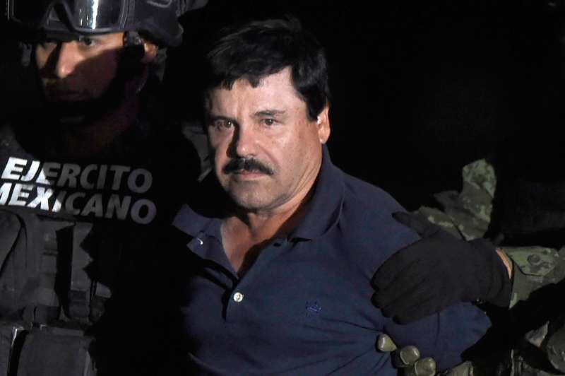 Drug kingpin Joaquin  El Chapo  Guzman is escorted to a helicopter at Mexico City's airport on January 8, 2016 following his recapture during an intense military operation in Los Mochis, in Sinaloa State. Mexican marines recaptured fugitive drug kingpin Joaquin  El Chapo  Guzman on Friday in the northwest of the country, six months after his spectacular prison break embarrassed authorities.