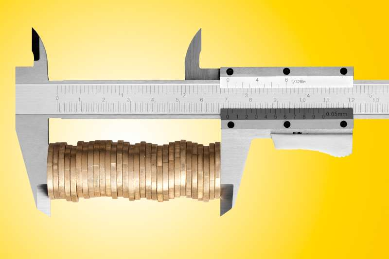 caliper with coins in it