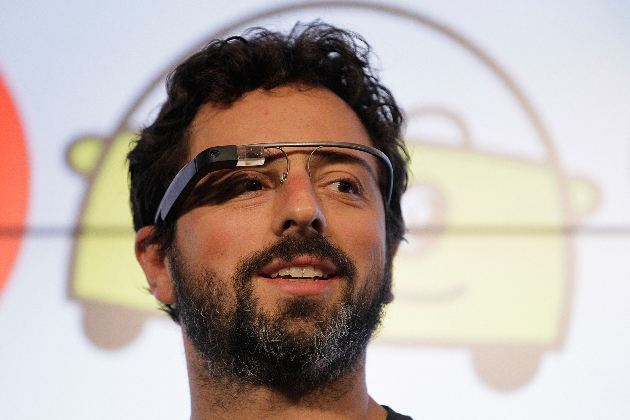 Google co-founder Sergey Brin stands on stage during a bill signing by California Gov. Edmund G. Brown Jr., for driverless cars at Google headquarters in Mountain View, California, September 25, 2012.