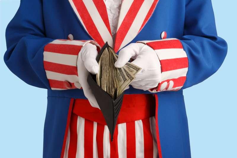 Uncle Sam holding wallet