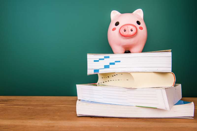 piggy bank on top of books