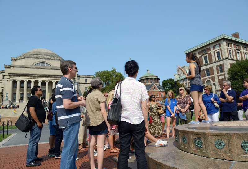 A student leader gives an admissions tour in the center of campus, Columbia University, August 8, 2014.