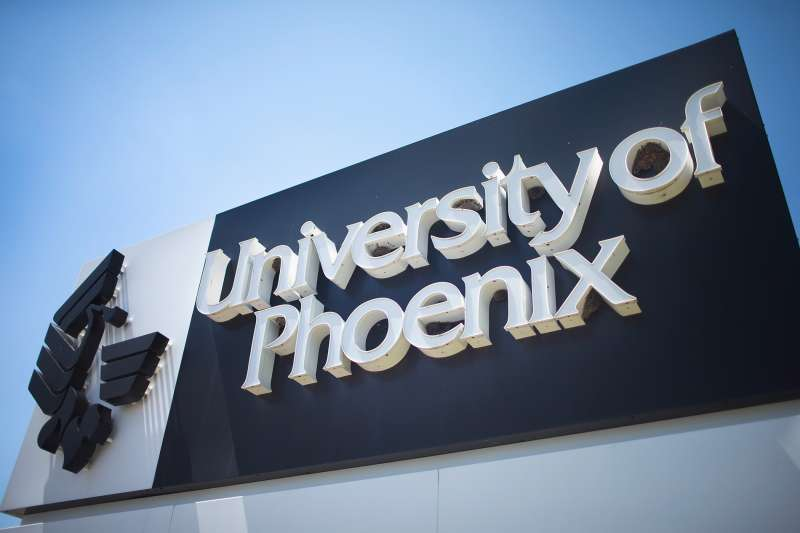 A sign marks the location of the University of Phoenix Chicago Campus on July 30, 2015 in Schaumburg, Illinois.