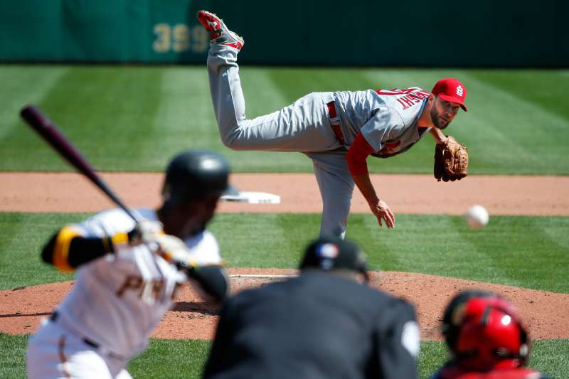 St. Louis Cardinals starting pitcher Adam Wainwright (50) delivers to Pittsburgh Pirates' Andrew McCutchen (22) during the fifth inning of the opening day baseball game in Pittsburgh, Sunday, April 3, 2016. The Pirates won 4-1, with Wainwright taking the loss.