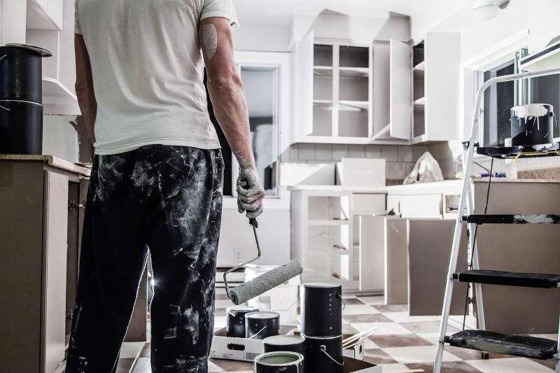 man renovating kitchen