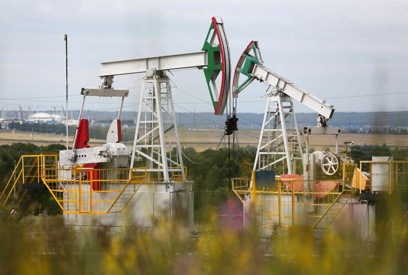 Oil pumping units, also known as  nodding donkeys  or pumping jacks, stand on an oilfield operated by Tatneft OAO near Almetyevsk, Russia, on July 31, 2015.