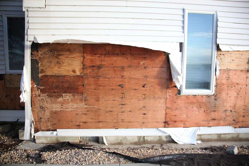 House damaged by winds and water