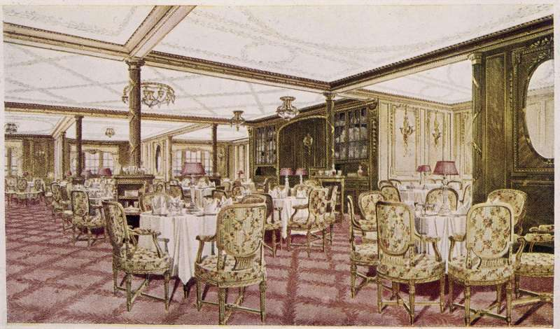 The first class dining room of the White Star liner 'Titanic', circa 1912.