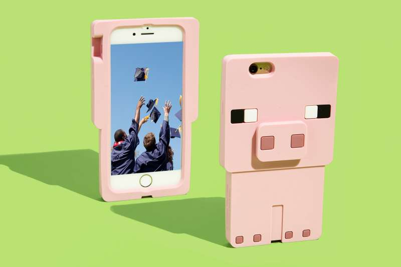 pig phone case with graduates tossing caps on screen of phone