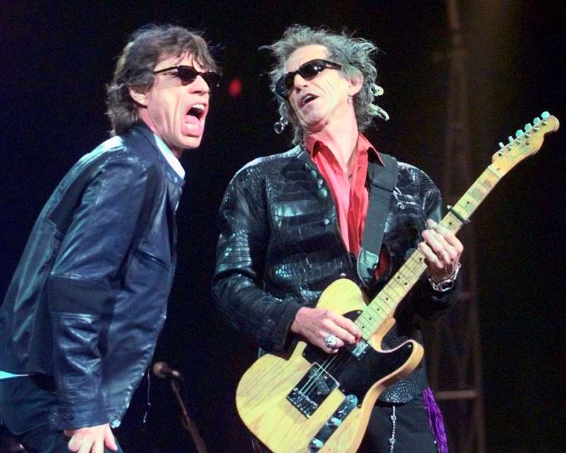 In this Monday, March 22, 1999, file photo, Mick Jagger, left, and Keith Richards perform  Jumping Jack Flash  during the Rolling Stones' No Security Tour performance at the Fleet Center in Boston. Goldenvoice Entertainment, a subsidiary of AEG Live, announced Tuesday, May 3, 2016, that Paul McCartney, The Rolling Stones, Roger Waters, Neil Young, The Who and Bob Dylan will perform for Desert Trip, during a three-day concert, Oct. 7-9, 2016, at the desert grounds where the annual Coachella Valley Music and Arts festival is held in Indio, Calif.
