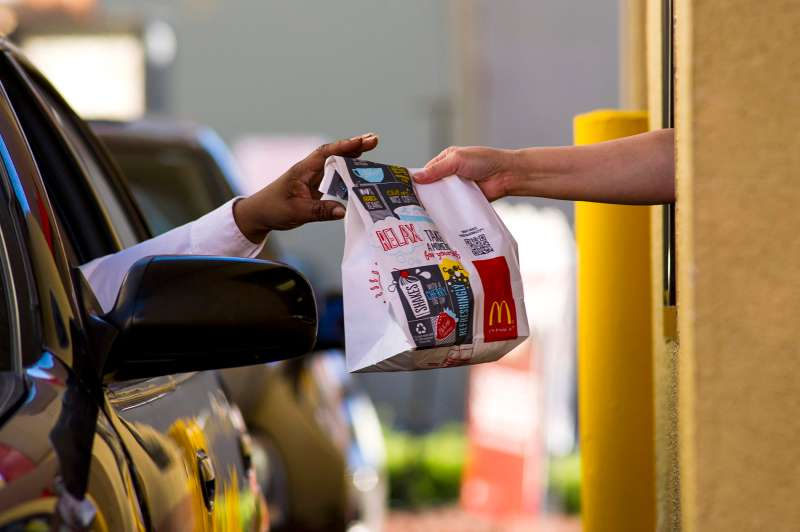 A customer receives an order from an employee at the drive-thru of a McDonald's Corp. restaurant in San Pablo, California, on Jan. 22, 2014.