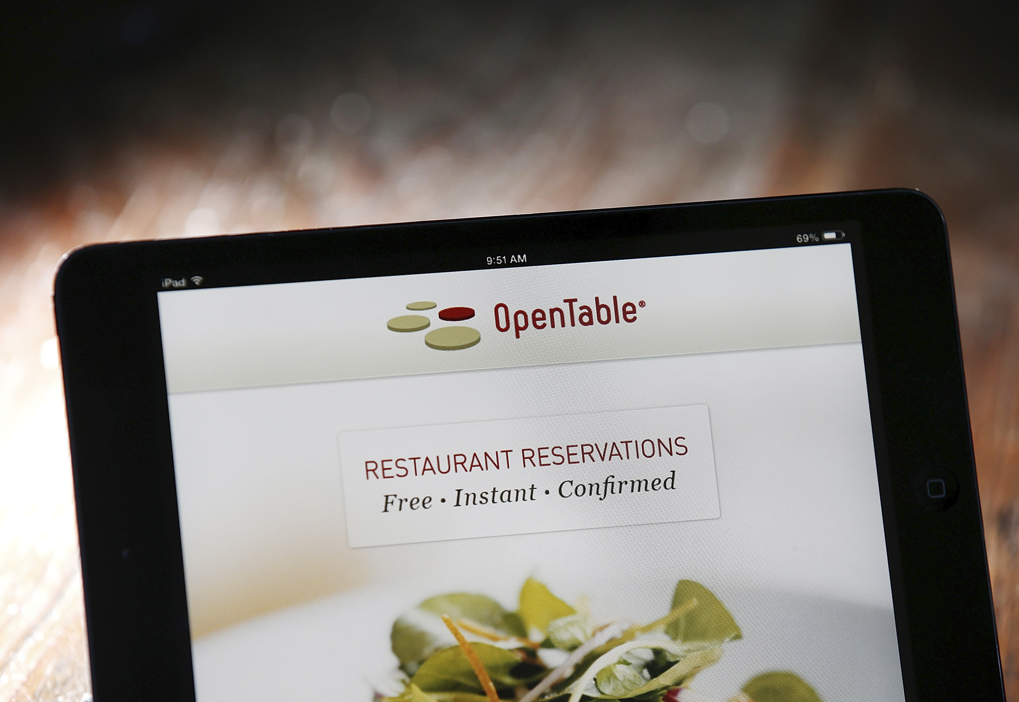 In this photo illustration the OpenTable website is displayed on mobile device on June 13, 2014 in San Anselmo, California.