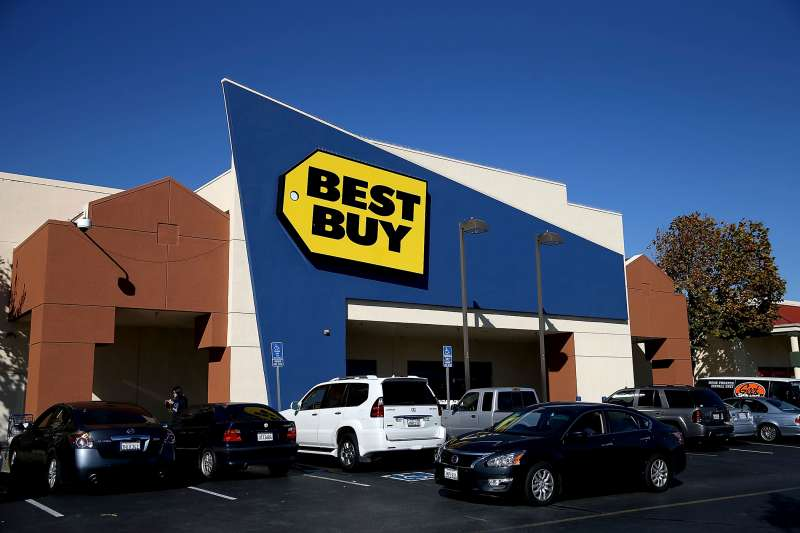 A car drives by a Best Buy store on November 19, 2015 in San Bruno, California.