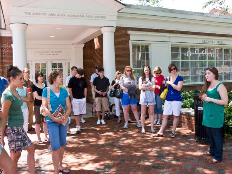Parents and prospective students on student-led admissions office tour of Tufts University crossing campus.