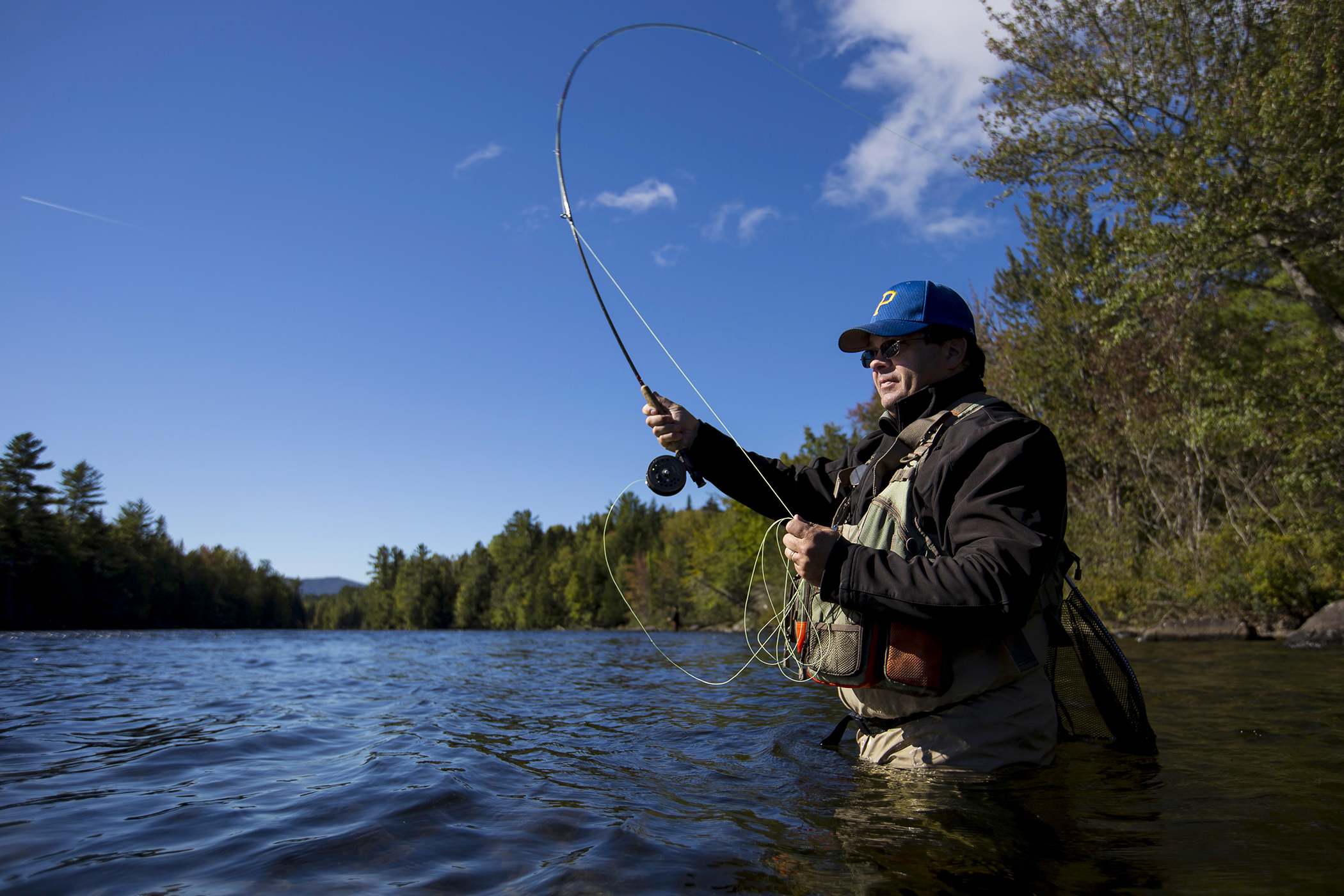 Tim Richardson, of Dover-Foxcroft, casts a line into the Kennebec River, September 26, 2015.