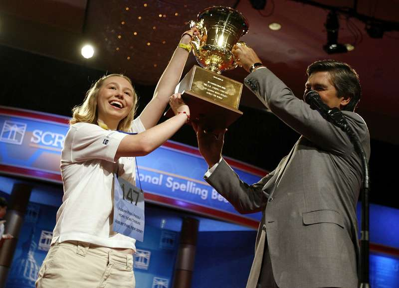 Katharine Close, 13, of Spring Lake, New Jersey, gets a hand from EW Scripps Company CEO Ken Lowe while holding up the championship trophy after winning the 2006 Scripps National Spelling Bee June 1, 2006 in Washington, DC. Katharine won after spelling the word  Ursprache.  She is the first female winner of the bee since 1999.