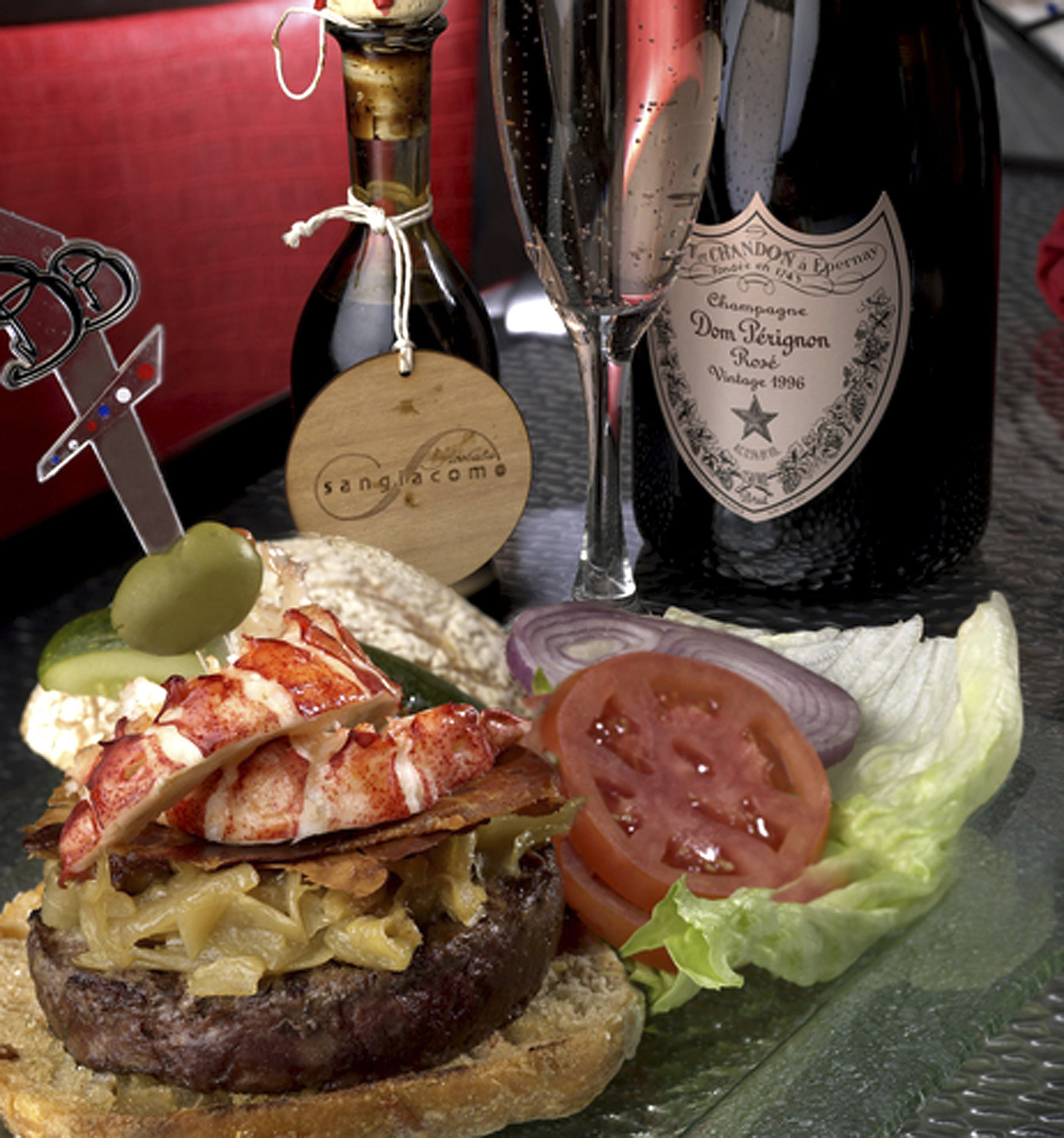 Brasserie in Paris Las Vegas, Nevada. . Consisting of Kobe Beef and fresh Maine Lobster, caramelized onions, imported brie cheese, prosciutto, 100 year aged balsamic vinegar - served with a bottle of Rose Dom Perignon champagne.