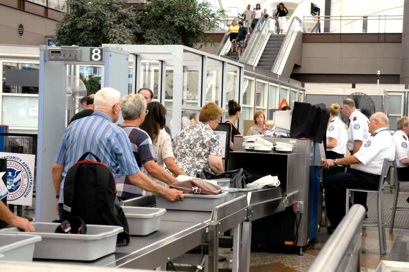 People wait in security line at Denver airport