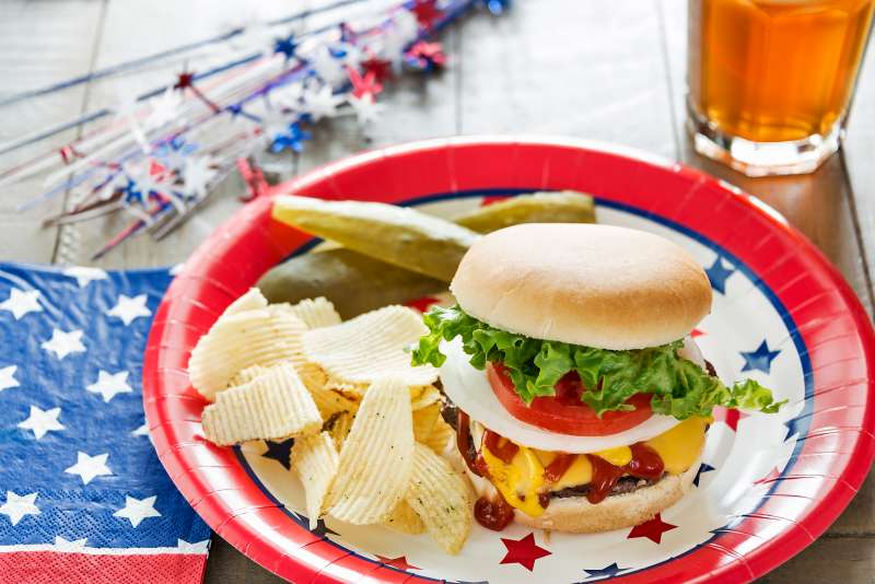 Cheeseburger loaded with toppings in a patriotic theme