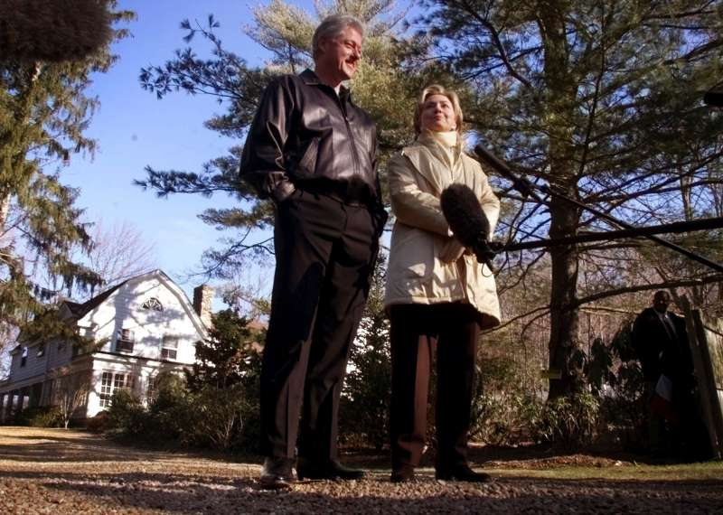 Hillary Rodham Clinton and President Bill Clinton stand in the driveway of their $1.7 million Chappaqua, N.Y., residence after spending their first night in the house, January 6, 2000.